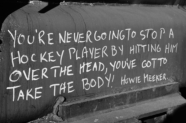 "You're Never Going To Stop A Hockey Player By Hitting Him Over The Head, You've Got To Take The Body "" - Howie Meeker"